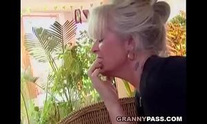 Busty granny takes juvenile cock