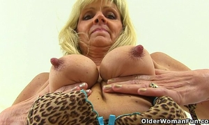 British gilf dolly pushes a sex-toy up her fanny