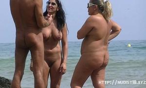 Nudist beach voyeur discharges stripped honeys sunbathing