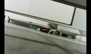 Under stall water closet voyeur two