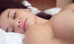 Cute oriental honey with large pantoons is playing with her snatch
