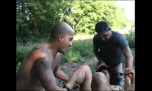 A brunette hair caught alone in the country is group-fucked by strangers