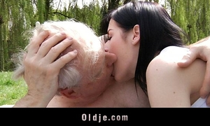 Young brunette hair floozy copulates with grandad in the park