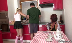 Future mother and legal age teenager toying at the kitchen