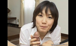 Alluring and perverted japanese cutie giving head seductively