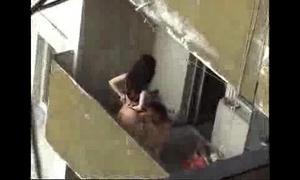 Spy movie scene of next door cheating amateur wife fucking on the balcony