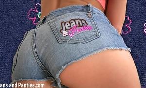 Skinny honey alex teasing in constricted dark jeans