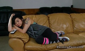Tattooed oriental nanny drilled on leather sofa
