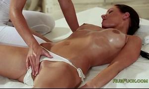 Brunette in pants acquires snatch massage