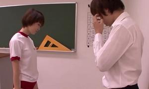 Young asian schoolgirl blowing teacher