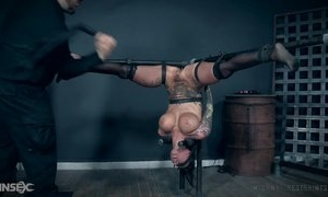 Inked bitch with fake tits pleasuring her master in BDSM action