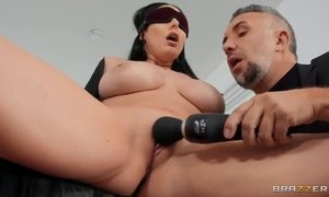 Raven-haired porn babe in high heels pleasuring Keiran on the couch
