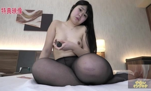 Thick Asian girl with natural boobs masturbates passionately in bed