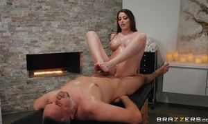 Buxom slut oils herself up and fucks client during a massage